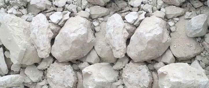 Quicklime or calcium oxide is used commonly for whitewashing houses. The chemical formula of quicklime is CaO